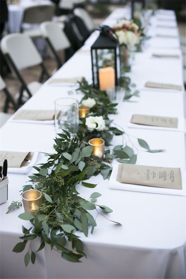 Home » Wedding Ideas » COLOR OF THE YEAR 2017 – Greenery Wedding Centerpiece Ideas » Greenery garland down the head table made with seeded eucalyptus and rosemary