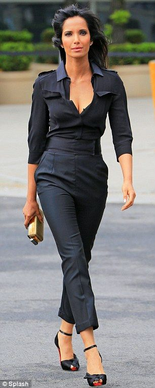 Padma Lakshmi in a chic navy jumpsuit, wide waist belt and ankle-strap heels