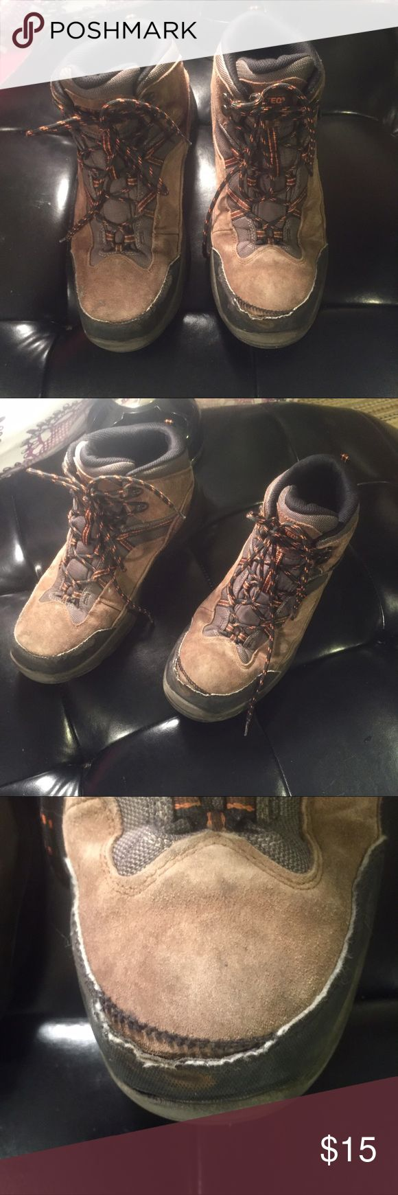MENS HI-TEC HIKING BOOTS. Waterproof These boots are in great condition. One inseam of the toe has come apart. Will glue under inseam with heavy duty waterproof . Price reflects use' Hi-Tec Shoes Boots