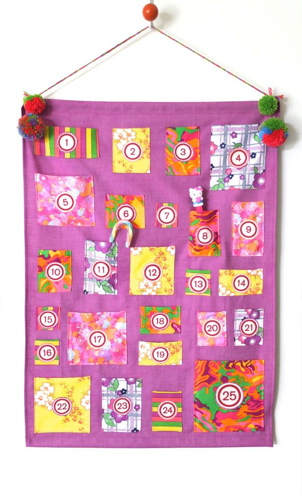 Advent calendar, found on : http://mypoppet.com.au/2012/11/how-to-advent-calendar-wall-hanging.html#
