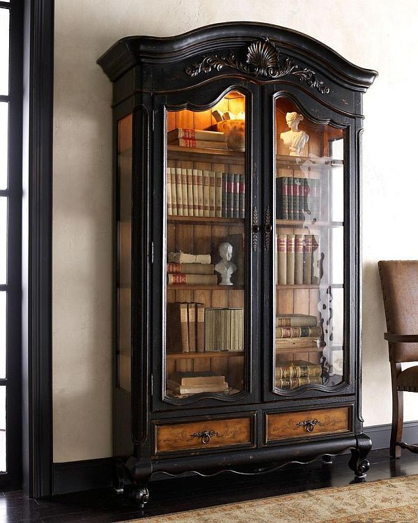 beautiful mixture of painted and natural wood. I love the glass doors, the internal light and the book arrangement.