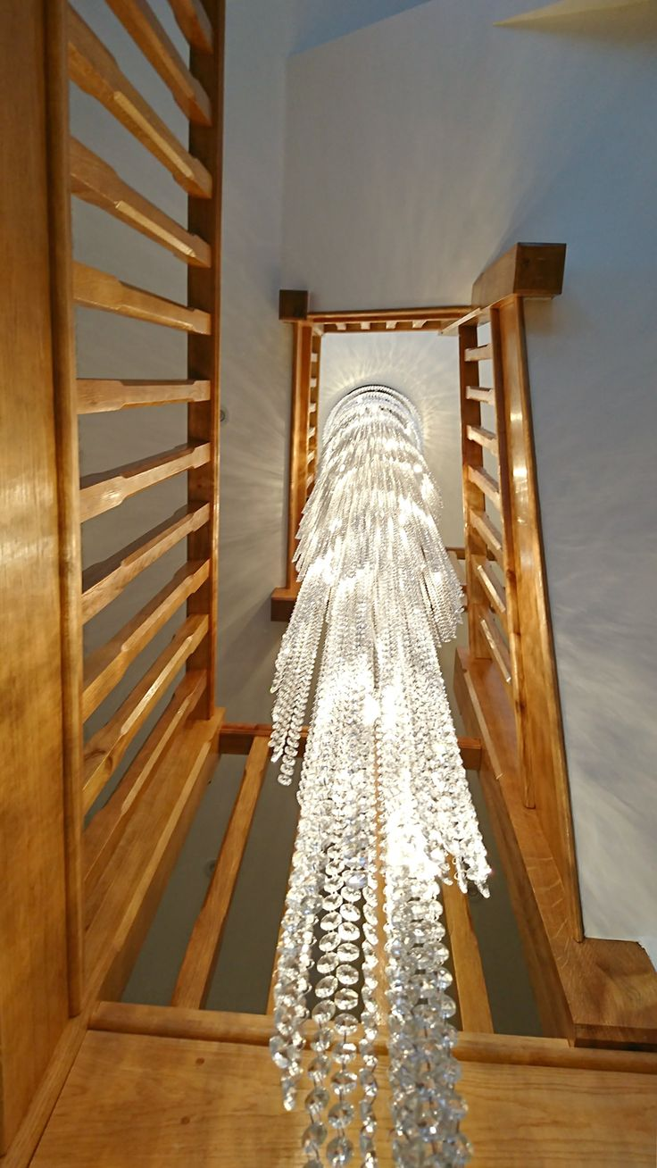 """Another #custom chandelier just installed. This """"Twister"""" #crystal #chandelier illuminates the stairs of a private house in #London."""