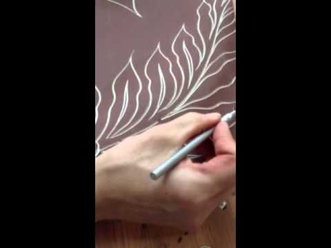 ▶ Carving a ceramic wall tile - YouTubeNatalie Blake creates amazing tile murals. Here is part of her technique.