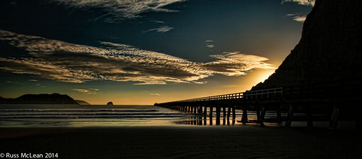 """""""Tolaga Bay Sunrise"""" - The new day dawns on the East Coast of New Zealand almost before anywhere else in the world. It also dawns on this fine example of New Zealand's yesteryear."""