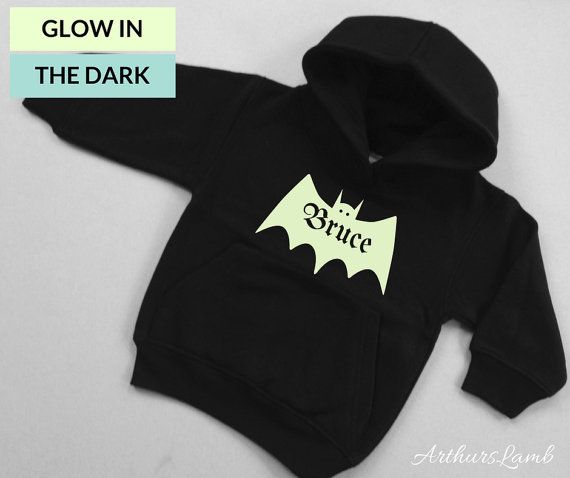 Bats are super spooky, especially at Halloween!! And with this personalised Glow in the Dark Bat hoodie you are sure to stand out!! So whether you are looking for a something to wear when you go out to trick or treat or a Halloween gift, this sweater/jumper personalised with any name will be a much loved addition to the spooky day!! When ordering, please note the name required in Comments to Seller box during checkout. These Black Hoodies with their Glow in the Dark graphics are a great…