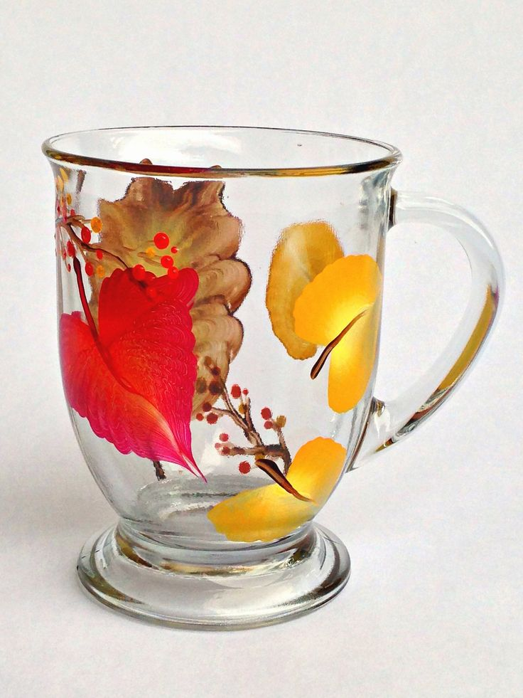Three kinds of colorful autumn leaves and bittersweet berries hand-painted encircling quality 16 ounce footed cafe mug, perfect for all hot beverages. Top-rack dishwasher safe; hand-washing preferred.                                                                                                                                                                                 More