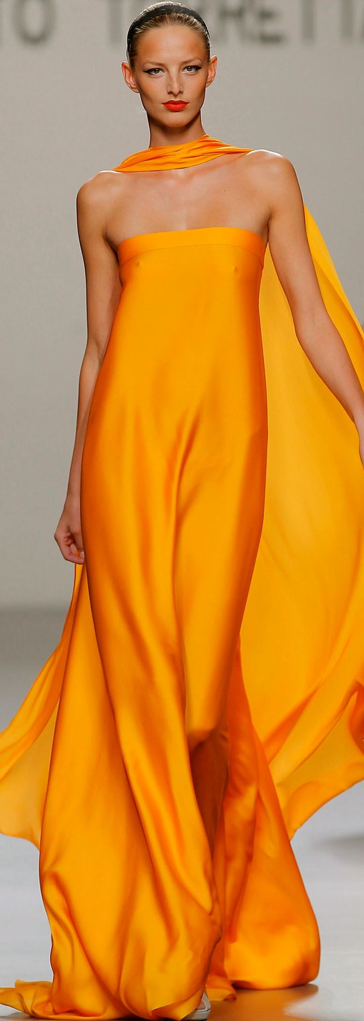 Beautiful gown. BUT, people getting her all ready to head out on the run way should make sure everything is lined up! Just sayin'. It's something I just notice. #Orange #Chic #Style #Summer #Beautiful #WednesdayWant
