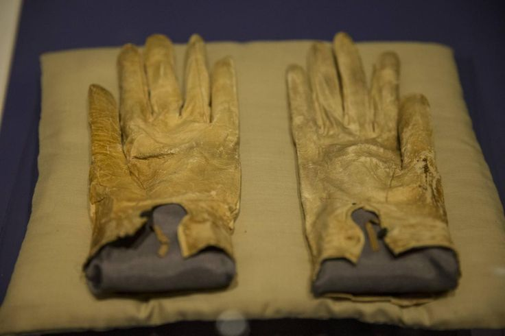 President Abraham Lincoln's blood-stained gloves that were tucked into his coat pocket at the time of his assassination are displayed at the Abraham Lincoln Presidential Library and Museum in Springfield, Ill., on March 21. (Whitney Curtis/Reuters)