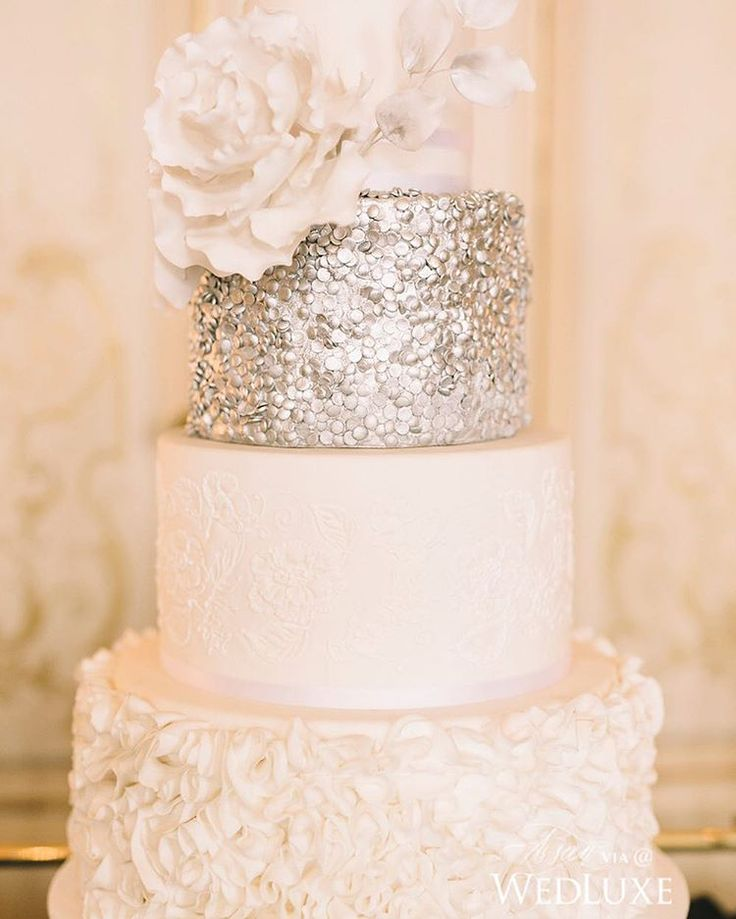 From the textured, sugar ruffle base to the silver confetti detailed tier and blooming sugar peony, there is little from this #cake by @demel_wien that doesn't speak to the romantic, modern #bride! See more from this #Viennese #styledshoot on WedLuxe.com today! (: @paulavisco, concept creator and producer: @highemotionweddings, cake: @demel_wien)