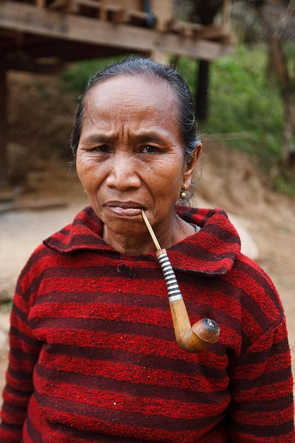 Pipe smoking lady in Laos....Photo by Philippe Tarbouriech... my kind of lady...