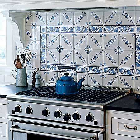 This back splash tile was hand-painted by a local artist and ties in with a blue pantry, which is built-in around the corner in the mudroom. Check out the whole house @This Old House.com. | Photo: Laura Moss | thisoldhouse.com