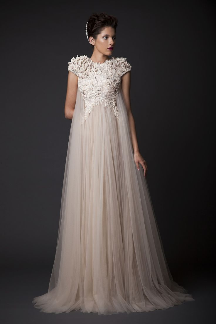 Krikor Jabotian...Wow, interesting details. Cheaper to have custom-made than purchasing from salon. Try different fabric & embellishments ideas to fit your wedding theme but keep the details.