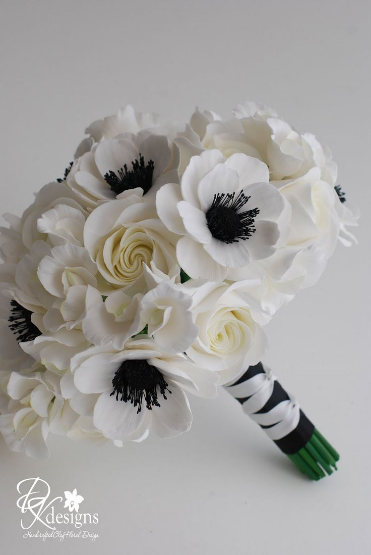 Specializing in handcrafted clay floral designs and simply stylish wedding stationery.