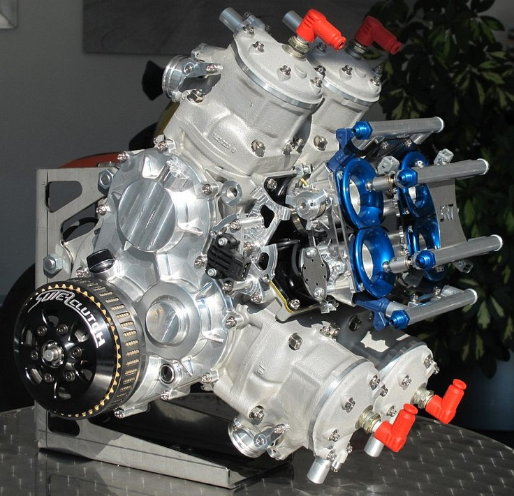 Engine Type4 Cylinder V4 two stroke  double counter rotating crankshaft, roller bearings  Displacement54 x 54,5  (56 x 58,5 optional version)  Powermin. 200hp  AspirationElectronic fuel injection  four port throttle body  four carbon reed valve  Exhaust ValveDouble flap  electronic controlled  Exhaustfour single resonance steel chambers  (optional Titanium)  GearboxSRT six speed cassette gearbox  ClutchSuterClutch multi disc dry  IgnitionMarelli ECU