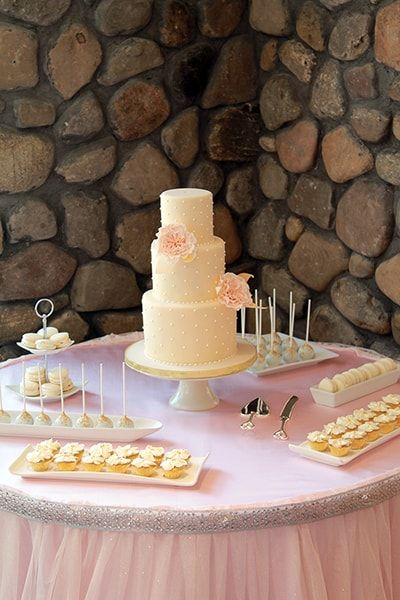 Vintage sweets table in ivory, peach and gold.