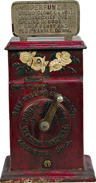 "1 Cent Self Selling Sales Co. ""Purity Perfume Vending Machine"" Perfume Sprayer c1910, cast-iron case. The perfume is sprayed out of the embossed roses at the top of the machine, in excellent original condition, rare w/ keys - 7""w x 5""d x 14""h"