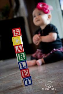 I love the shallow depth of field with the focus on the blocks instead of the baby. Might even be an easier shot because you don't have to worry about getting that perfect smile or whatever.