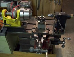 Metal Lathe - Homemade metal lathe constructed from surplus shaper and lathe parts, a compressor motor, connecting rods, and pulleys.