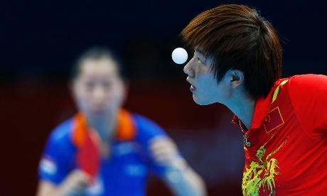 China's Ding Ning serves to Li Jie of the Netherlands in table tennis match