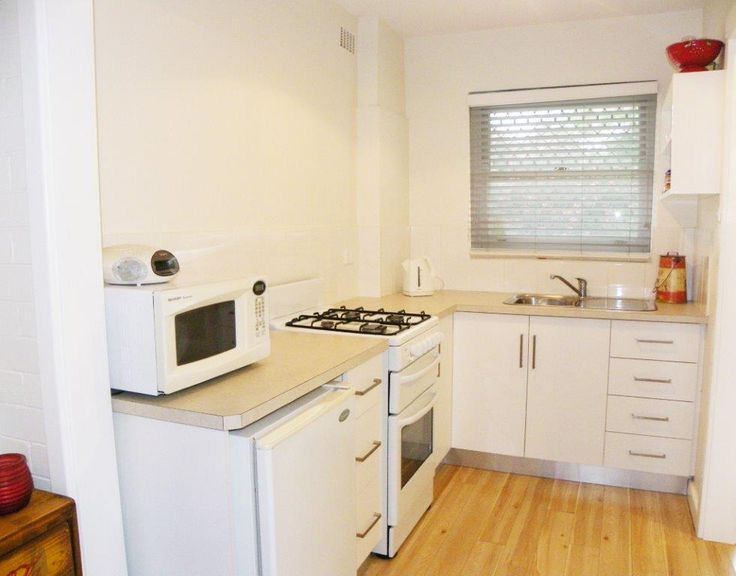 Bright kitchen with free standing electric stove/oven microwave, small fridge & cookware(note no dishwasher)