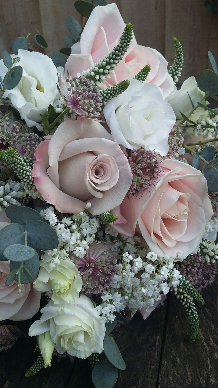 Blush pink roses, astrantia, lissianthus, veronica and gypsophila bridal bouquet.