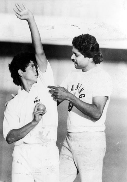 Indian Cricketer Sachin Tendulkar with Kapil Dev. Sachin must have picked some tips from  the great all-rounder.