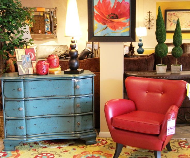 SteinWorld chest, Best Home Furnishings Elnora chair, and Surya Rug.