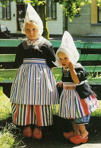 Two Dutch girls in traditional costumes, Holland  Reminds me of my two granddaughters, Jehané and Miecke.