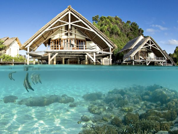 "Indonesia: Misool Eco Resort  ""This eco-hideaway, consisting of 13 breezy bungalows handcrafted out of salvaged driftwood, turns the old cliché that the journey matters more than the destination on its head: It's not easy to reach this remote outpost in Indonesia's Raja Ampat archipelago...""  Photograph courtesy Misool Eco Resort  #ecotravel #indonesia"
