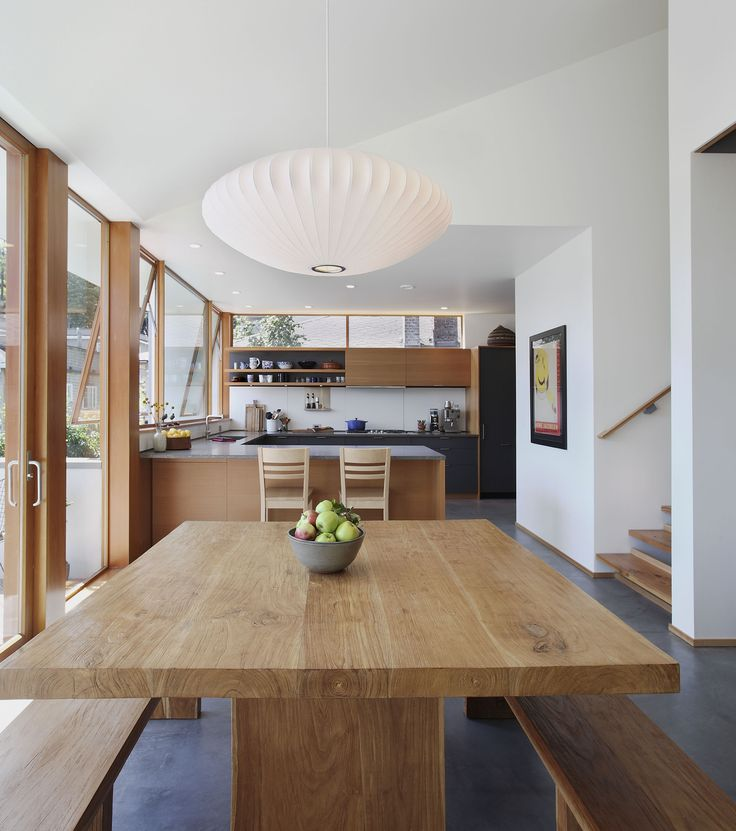 Nelson saucer over the table.  Also like the thin band of wood trim as a baseboard with the concrete floor & white walls