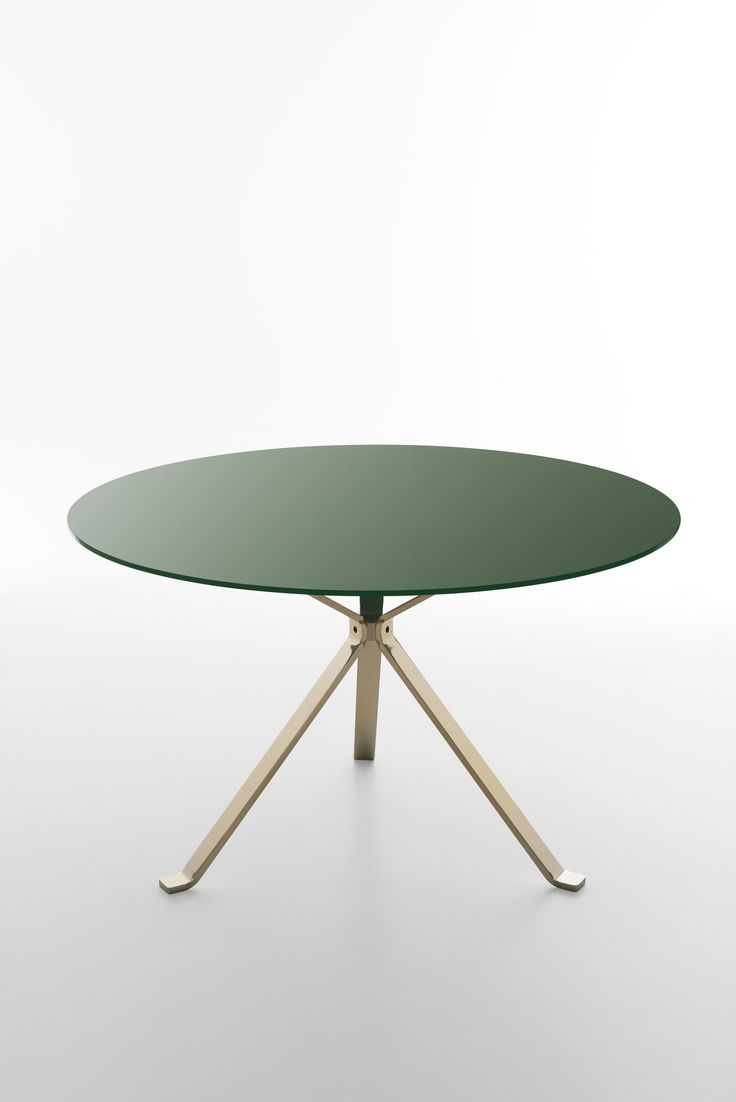 Revo table coll Reflection with round emerald tempered glass top and satin copper legs design by Progetto CMR  #focusoncolor #color design and finishing by Raffaella Mangiarotti #living #shining