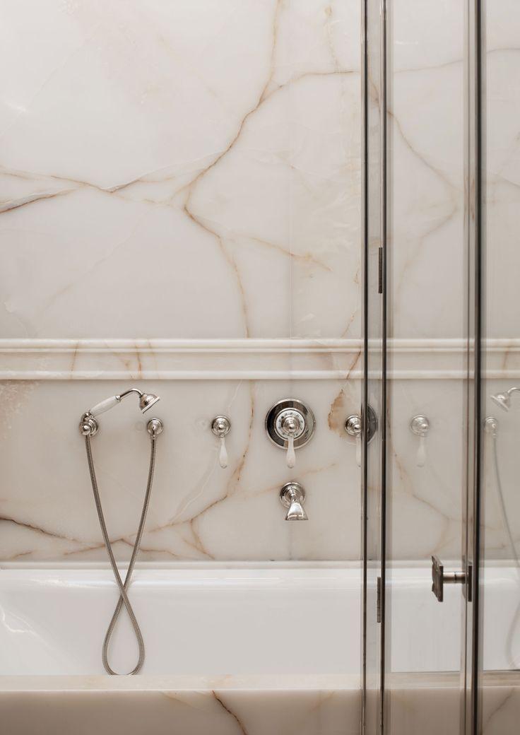 Marble veining bathroom slab on walls with polished nickel faucets hardware