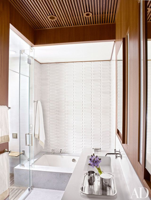 The master bath features Heath Ceramics tile and Corian countertop; the tub fittings and sink fittings are by Waterworks.