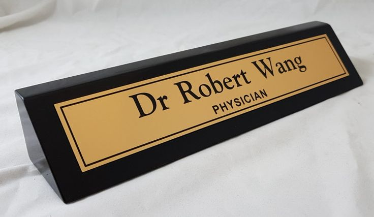 Jet Black Timber Deskbar. $49.50  Attractive jet black gloss finish timber desk bar. Can be made with either 1 or 2 lines of text.    Size 265mm x 49mm    Available with either a Gold or Silver laser nameplate, or a Black & Gold metal nameplate.