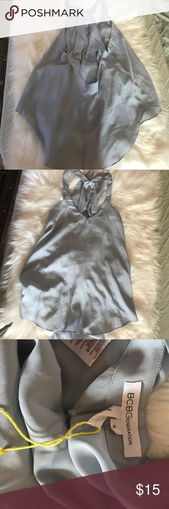 NWOT BCBG Ruffle Back Tank Show stopper. Lower cut back with ruffles. V-neck, hi-lo top. Flowy and breezy. BCBGeneration Tops Tank Tops