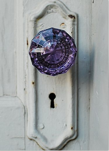 Vintage country feel for the door knob.love the pop of the purple against the shabby white.now I simply need the farmhouse for it to look lovely on.
