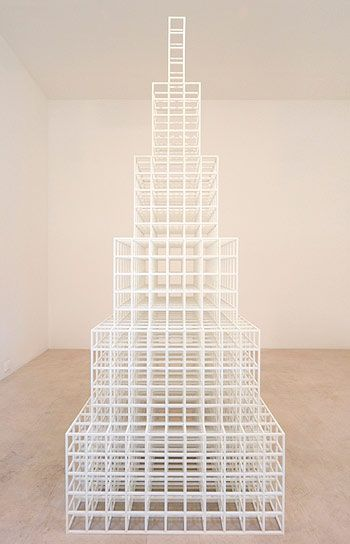 """Solomon """"Sol"""" LeWitt (1928 – 2007) was an American artist linked to Conceptual art and Minimalism. He came to fame in the late '60s with his wall drawings &""""structures"""" In the early 1960s, LeWitt first began to create his """"structures,"""" a term he used to describe his 3D work. His frequent use of open, modular structures originates from the cube, a form that influenced the artist's thinking from the time that he first became an artist."""