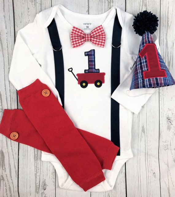 CURRENT PROCESSING TIME IS 10 BUSINESS DAYS, PLUS SHIPPING TIME. MONOGRAM IS INCLUDED IN PRICING, PLEASE PUT NAME IN NOTES WHEN ORDERING, IF DESIRED. Vintage Red Wagon Outfit! Includes options for bodysuit with embroidered applique red wagon with multi-blue plaid 1, red gingham bow tie, navy suspenders, party hat in multi-blue plaid with red 1 and navy pompom and option for red leg warmers. Please put in notes when ordering if you would like long or short sleeves. All of my creations are…