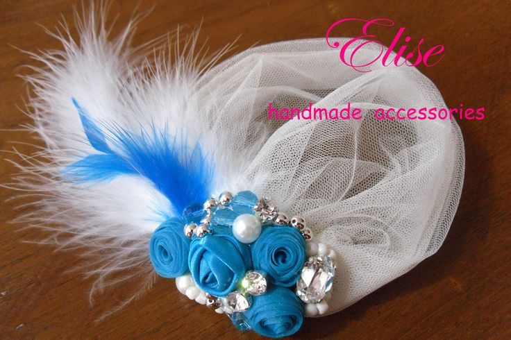 headpiece flowers blue tosca with feather white / tulle birdcage .. beaufiful :)