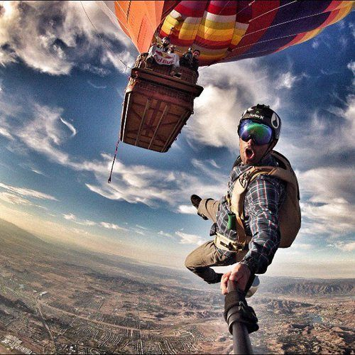 Just hanging around! Friends go upside-down skydiving together in ...