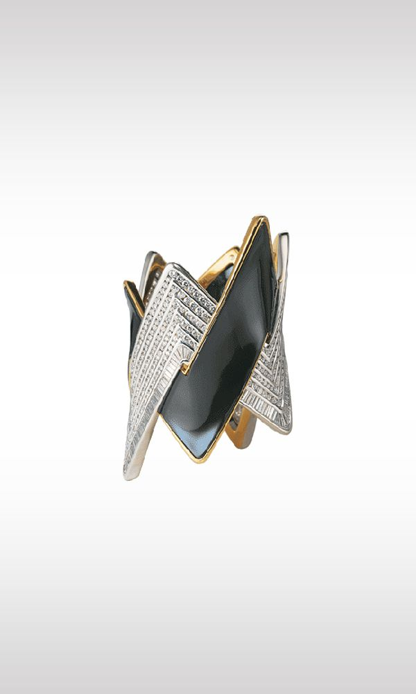 """Flash, 1992: an imposing bracelet emerges from a """"flash"""" of yellow gold, coloured gold and platinum, illuminated by brilliant and baguette cut diamonds, combining a captivating and aggressive design with a surprising richness of materials: 88.59 carats of diamonds, 184 grams of platinum and 188.30 grams of gold. What appears to be simply a magnificent expression of strength and vitality is an extremely difficult achievement of goldsmith's art."""