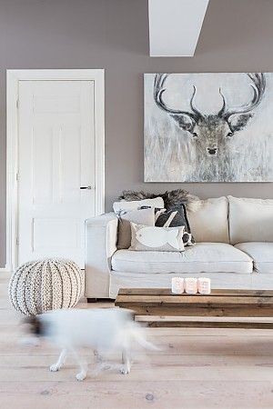 Love the brightness of this room and the art.