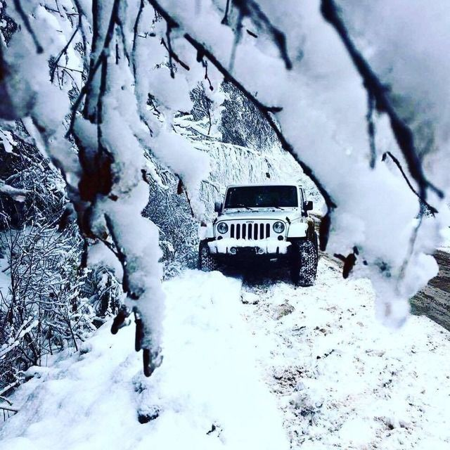 Snowy white Jeep..