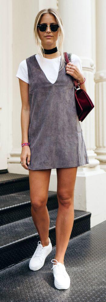 The thick width black choker + perfectly balanced + streamlined hairstyle + sunglasses + t-shirt under dress trend + Janni Delér + sporty chic. Sunglasses: RayBan, Choker: Na-Kd, Shirt: Bik Bok, Dress: Nelly, Bag: Chanel, Shoes: Senso