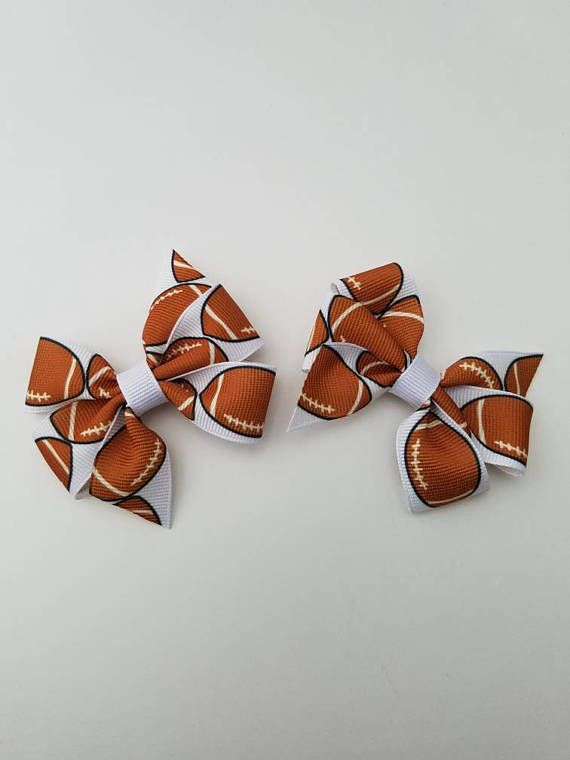 Check out this item in my Etsy shop https://www.etsy.com/listing/526671194/football-hair-clips-football-hair-bow