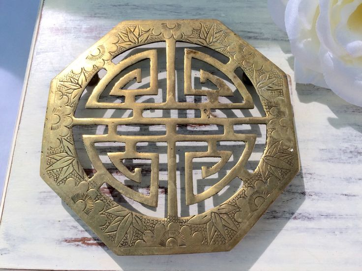 A personal favorite from my Etsy shop https://www.etsy.com/ca/listing/244481548/vintage-asian-trivet-etched-heavy-old