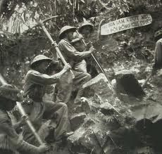 Viet Minh troops clear and digging to near to French fortress of Dien Bien Phu.