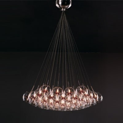 Starburst 37 light suspension features a clear glass globes with amber stars and a satin nickel finish. Thirty-seven 10 watt 12 volt G4xenon lamps included. General light distribution. Glass globe height is 6 inches. 33W X 72H.    Price: $1350.00