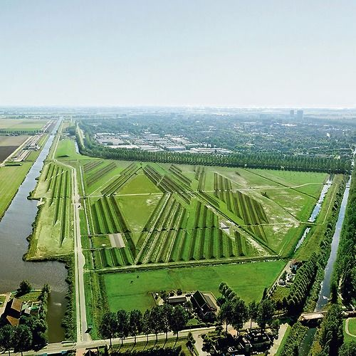 An acoustic buffer grooved into the landscape around Amsterdam's Schiphol Airport, by landscape artist Paul de Kort