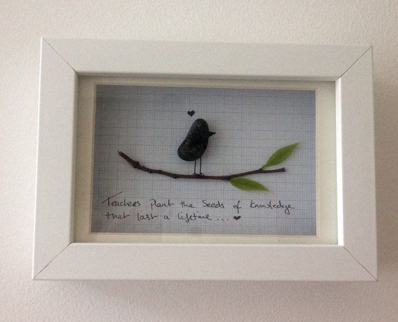 Pebble art picture, hand made in Ireland..  Made from pebbles found beachs in Ireland. A great gift for children to give to their teacher.     While no two pieces are the same, if you like any of the pieces you see, I can create pieces in a similar style.  All pictures are available in a white, black oak and gloss grey frames.  Please feel free to contact me